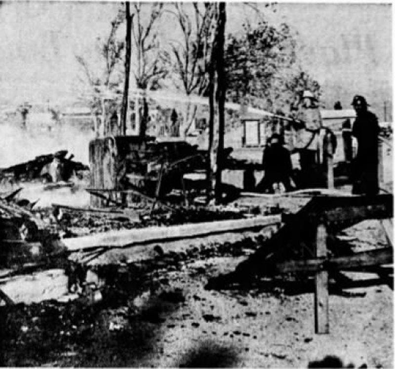 CHARRED RUINS — Firemen dampen the smoldering ruins of the Golden Stallion, Pioneertown restaurant which burned down yesterday.