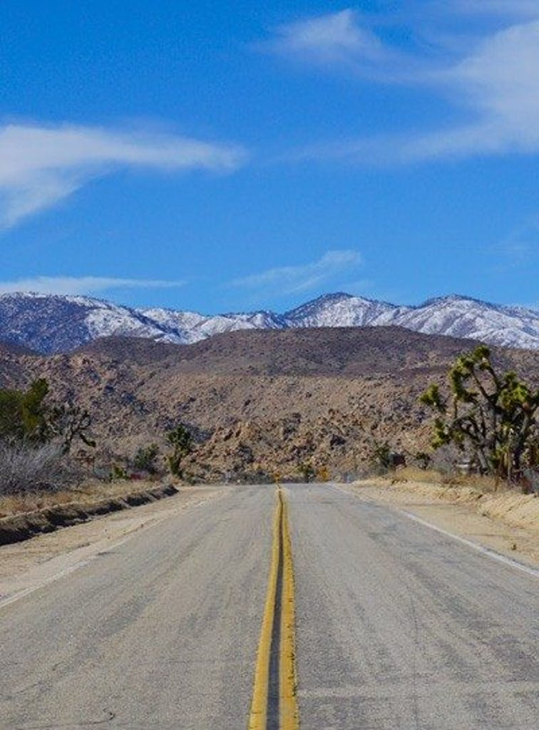 Pioneertown Road and snowy mountains photo