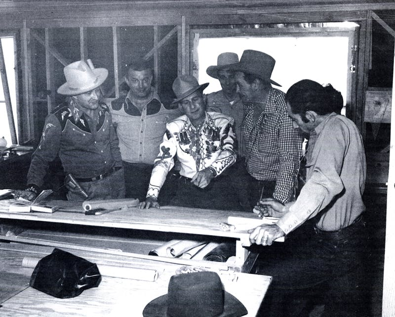 Lloyd Perryman, Bob Nolan, Bud Abbott, Tim Spencer and Dick Curtis reviewing plans
