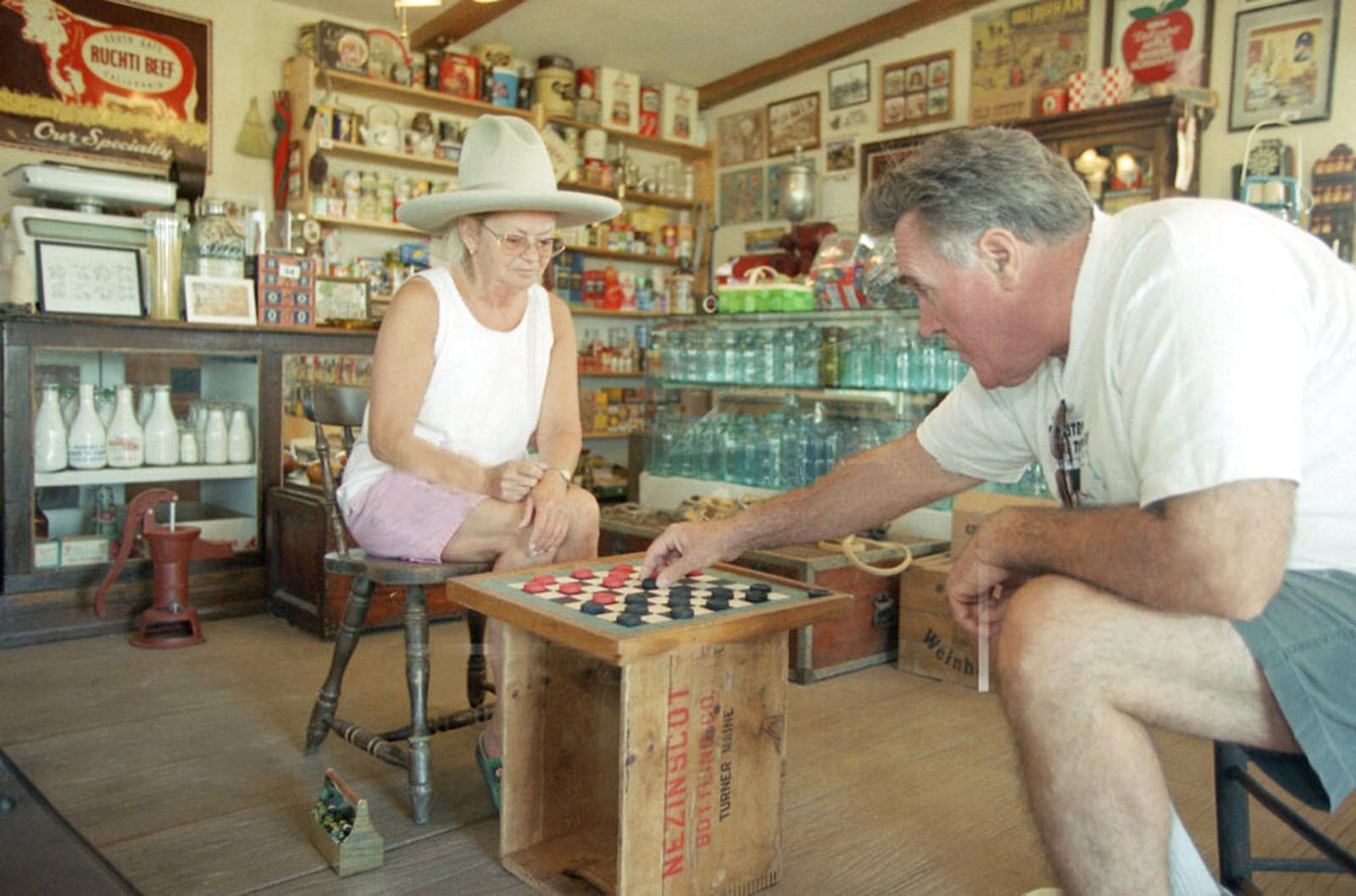 Monika Legrone plays John Rosemeyer in a game of checkers
